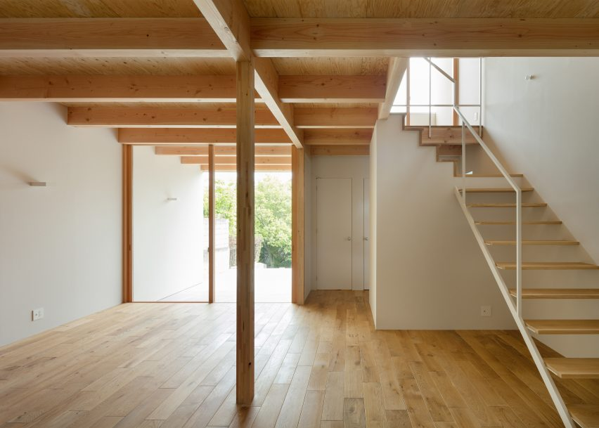 House in Mikage by Sides Core contrasts white surfaces with exposed wooden beams