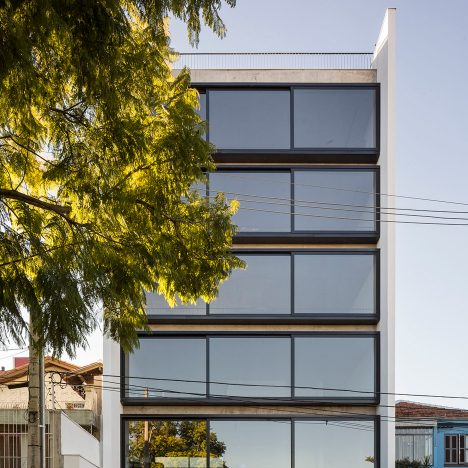 Brazilian apartment block by Arquitetura Nacional features a wall of sliding windows