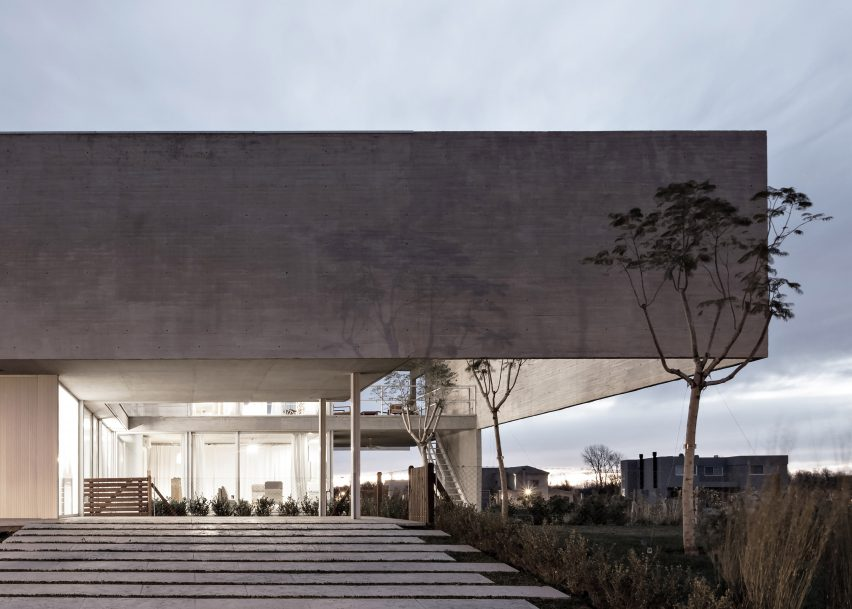 Moarqs and Ottolenghi Architects wrap Lamas House with concrete screen