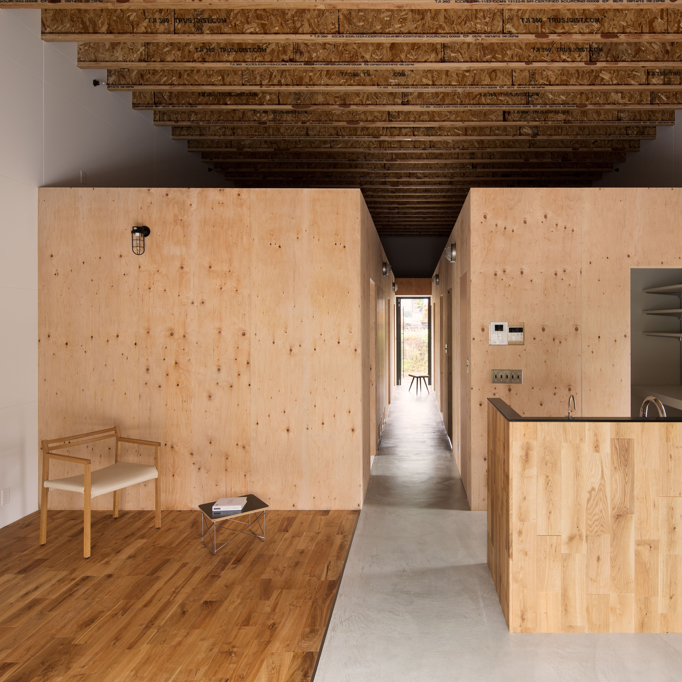 Wooden boxes define rooms and mezzanines in loft house by Wood architecture definition
