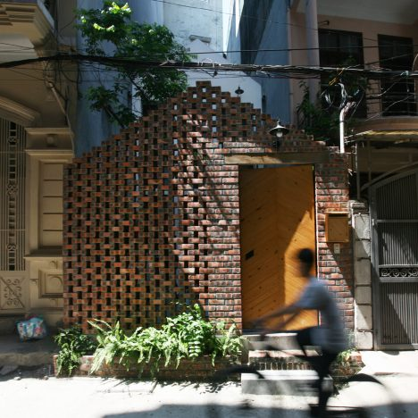 Perforated brick gable screens courtyard in front of compact Hanoi house