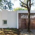 FCP Arquitectura pairs bright white walls with perforated iron screens at Mooe House