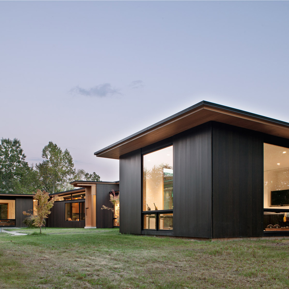 Carlton Architecture clads North Carolina home in dark cedar and weathering steel
