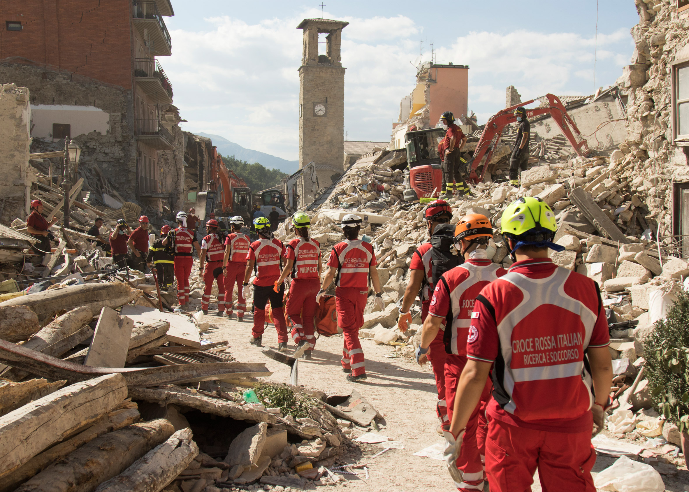 Merkel greets Italy quake rescue teams, dog