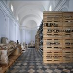 Storage crates form plinths for sculptures inside Microscape's Tuscan church conversion