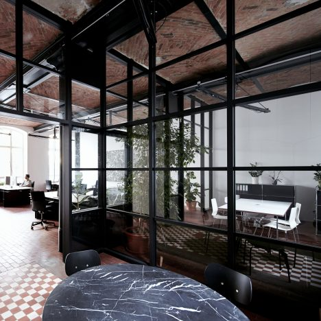 IFUB transforms former chocolate factory into office with secret storage