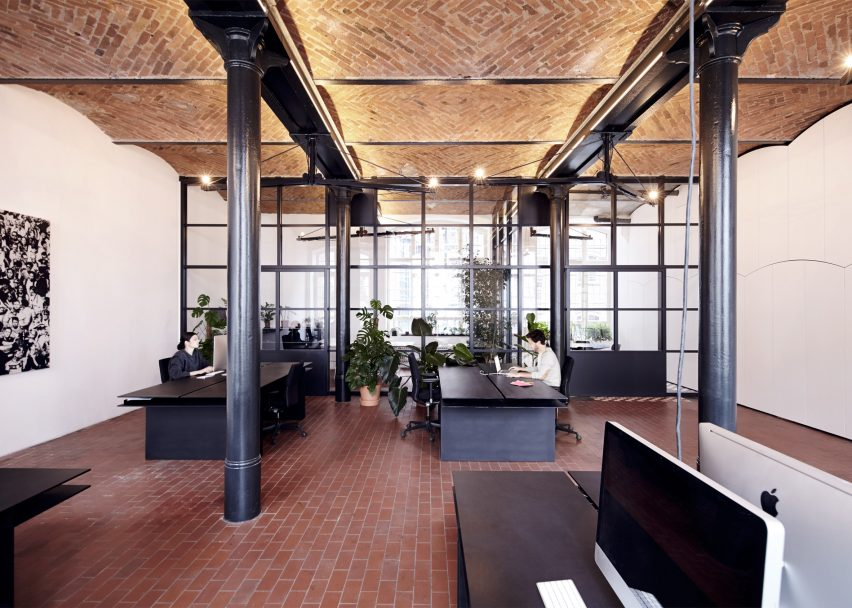 7 of 7 ifub transforms former chocolate factory into office with secret storage