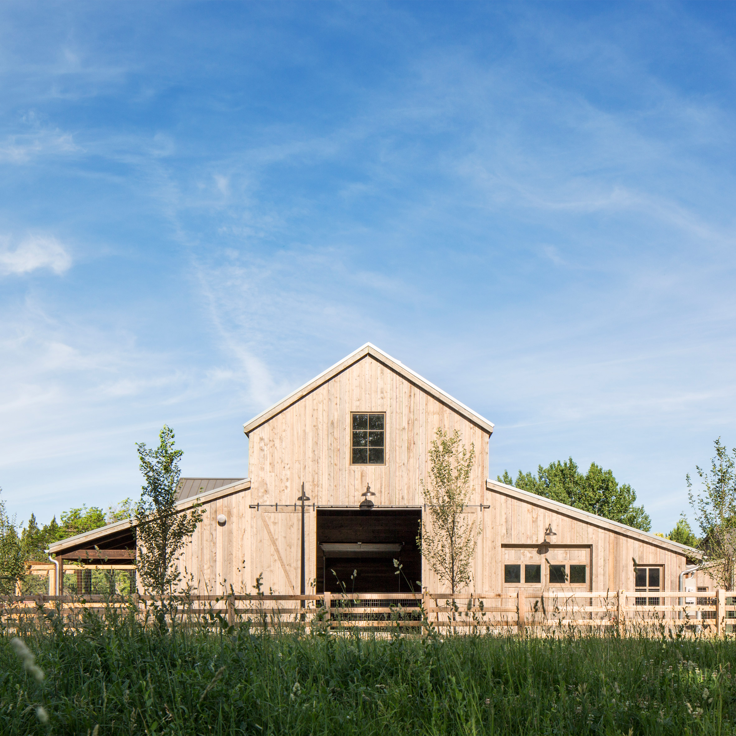 Lloyd architects builds community oriented farmhouse in for Farmhouse architecture