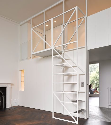 "Wireframe staircase leads to mezzanine sleeping ""nest"" in west London flat renovation"