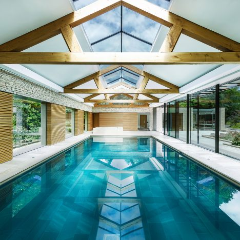 Contemporary pool house by Re-Format brings together stone, copper and oak