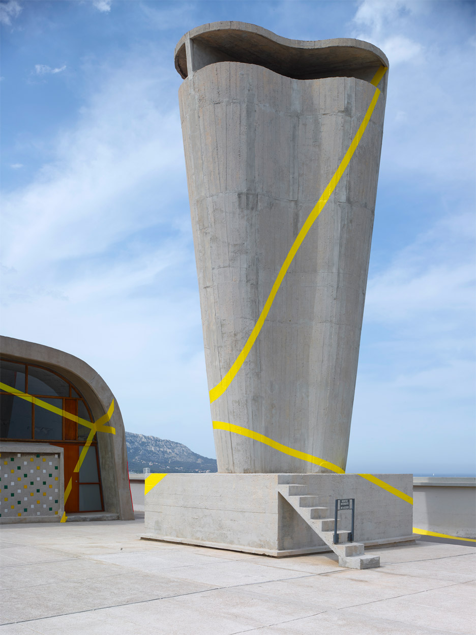 Felice Varini transforms rooftop of Le Corbusier's MAMO into optical illusion