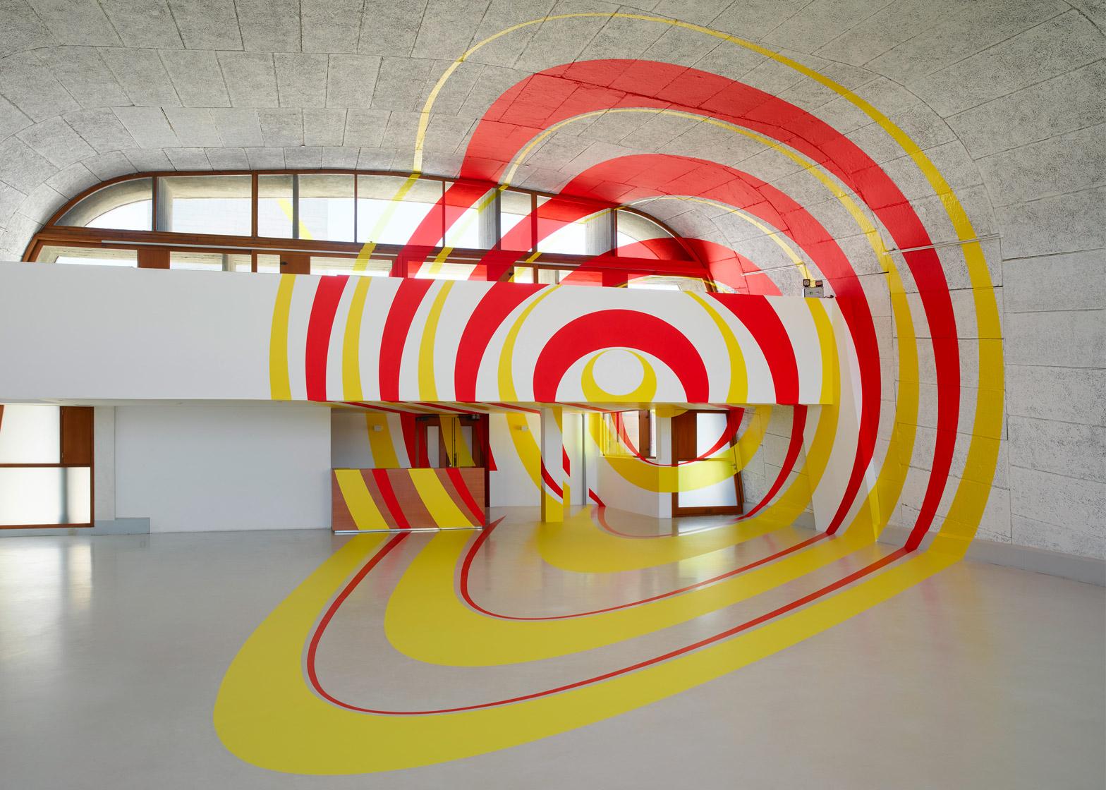Felice Varini transforms rooftop of Le Corbusier's MAMO into optical illusion