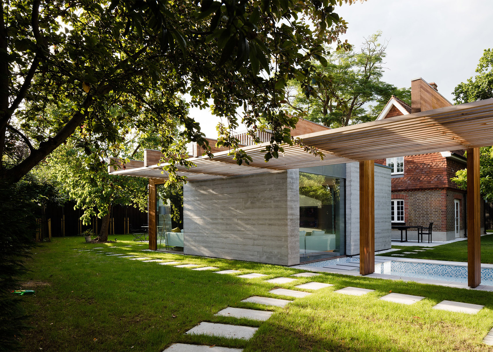 McGarry-Moon Architects adds concrete, timber and glass extension to a traditional gatehouse
