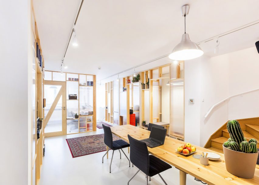 Economical workspace renovation in Warsaw by MFRMGR features semi-transparent walls