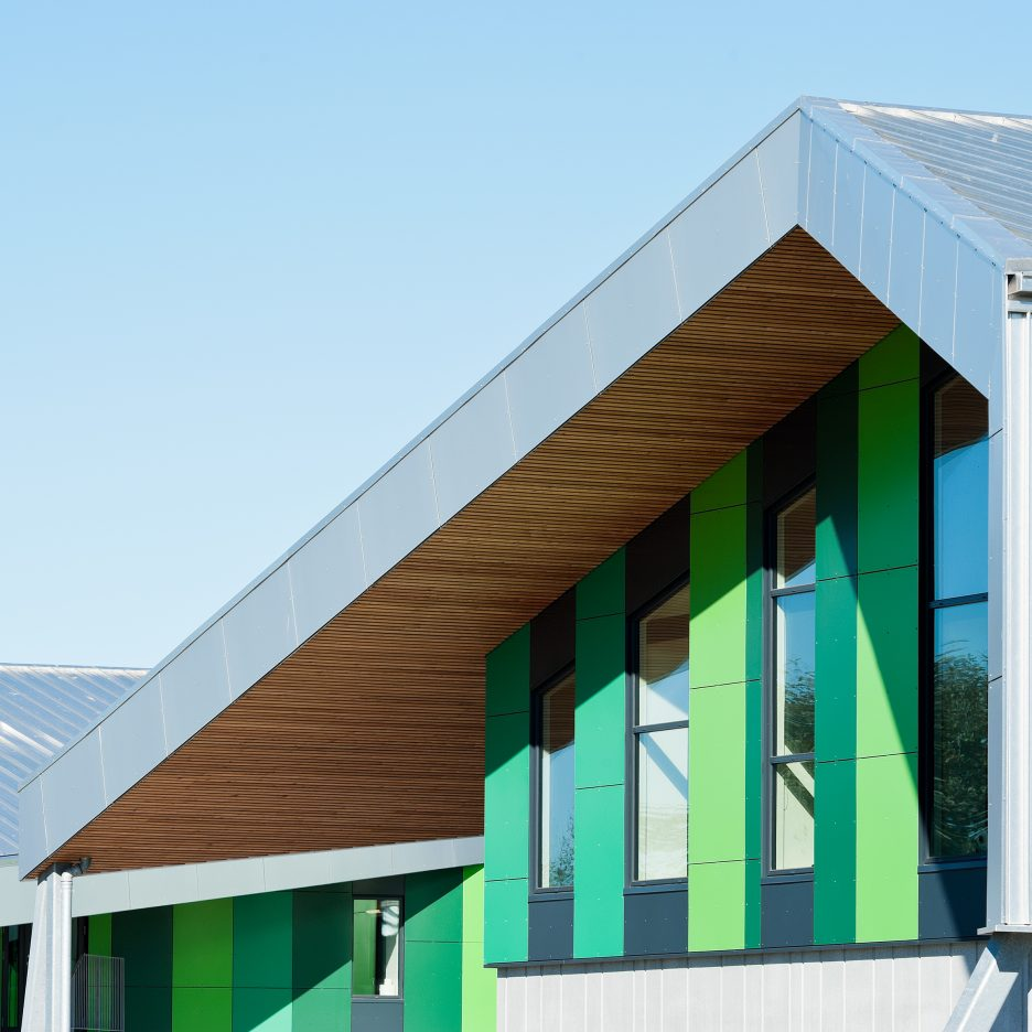 Cebra completes danish school with jagged roofs and stripy for Exterior design school