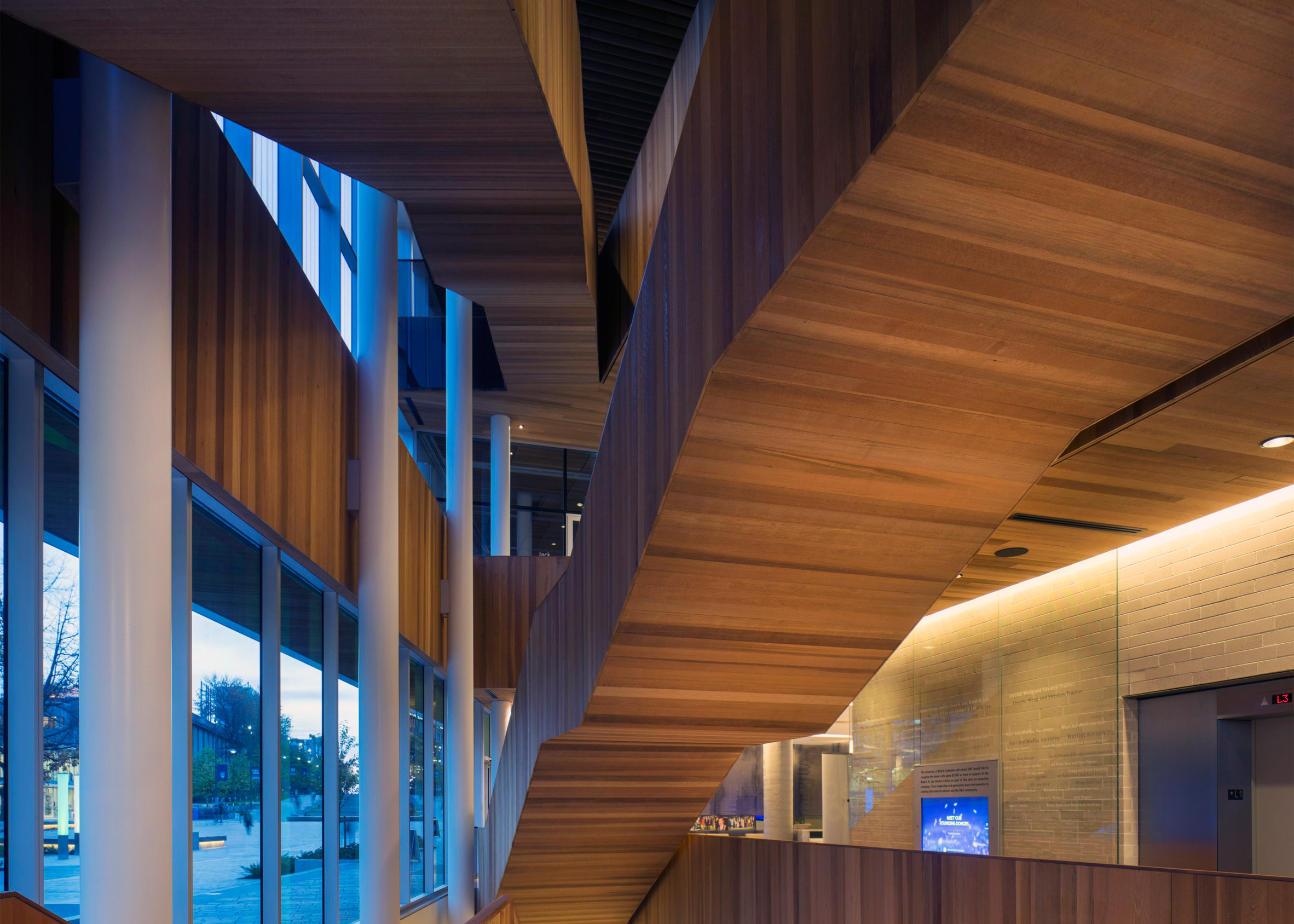 Vancouver university building by KPMB features fritted glass and rough-sawn cedar