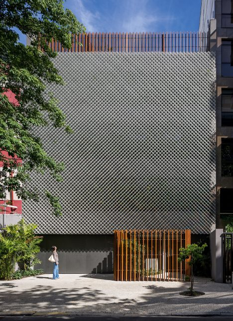 Bernardes Arquitetura completes Rio office block fronted by perforated metal and plants