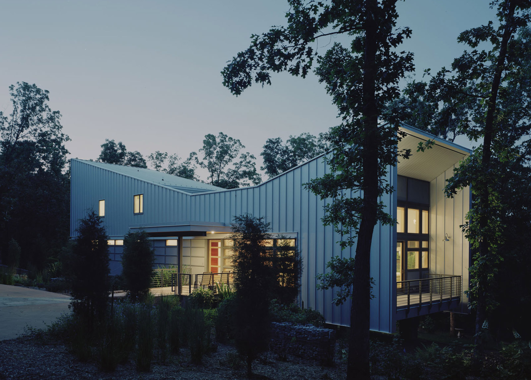 Bowtie House by deMx Architecture has an angular metal roof
