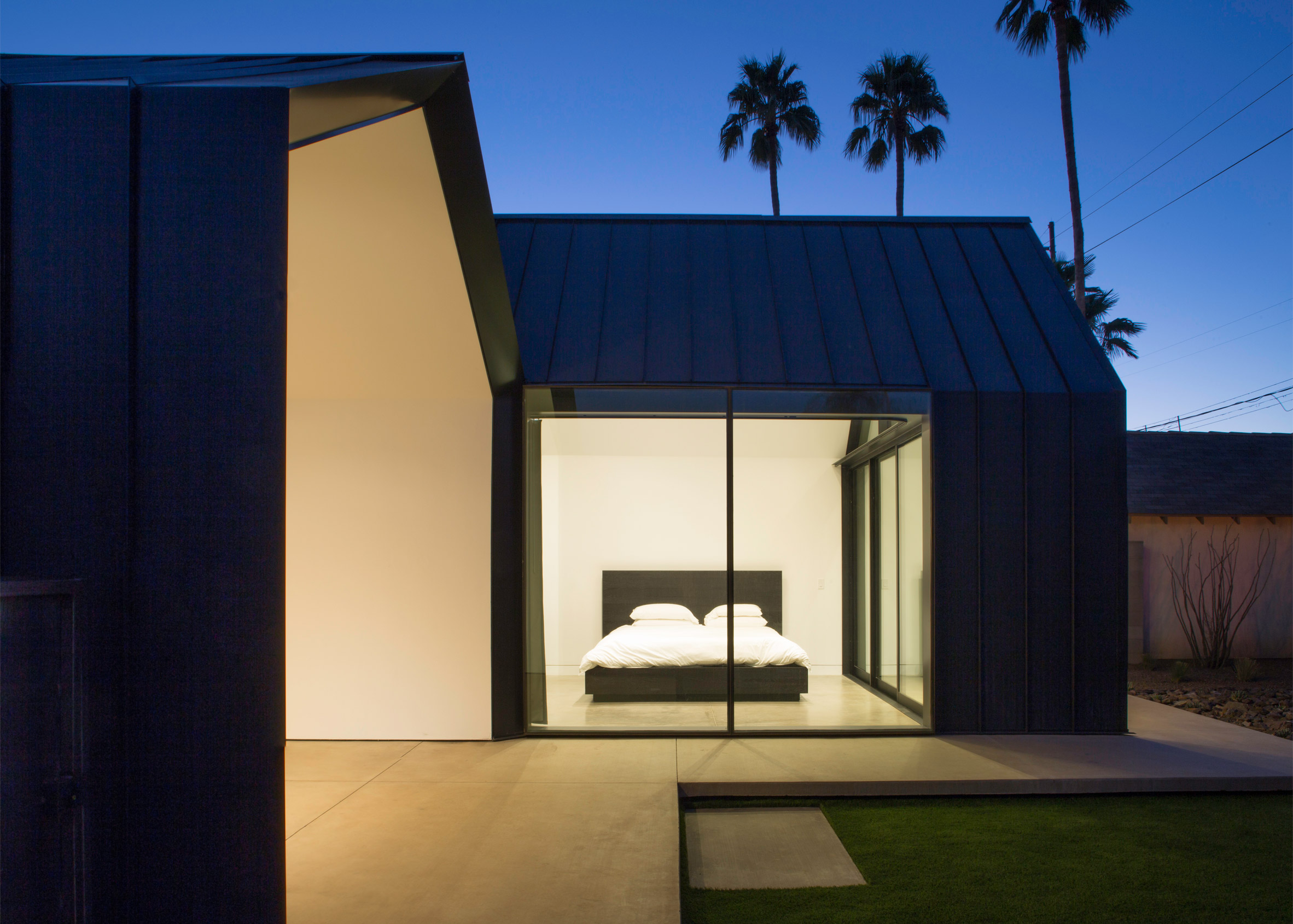 Chen + Suchart creates a gabled addition clad in metal for an historic Arizona home