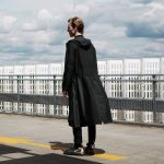 Senscommon designs unisex raincoat for cyclists with split hem to keep legs dry
