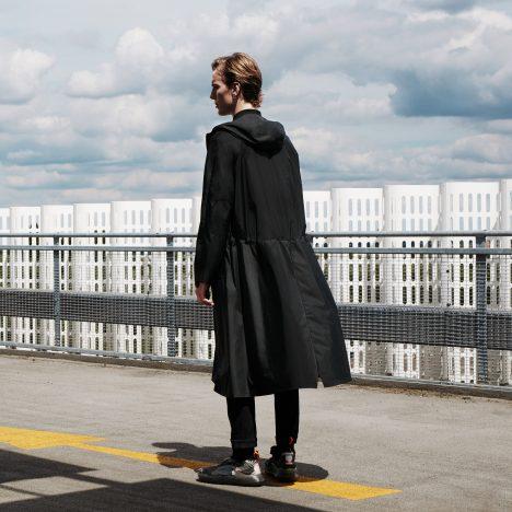 Senscommon designs unisex raincoat for cyclists with split hem to keep legs dry