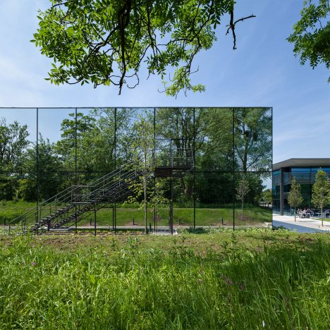 Wilkinson Eyre adds mirrored laboratory and sports hangar to Dyson's countryside campus