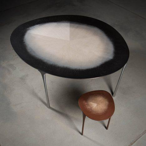 Studio UUffie captures wood grain in metal for Echo tables