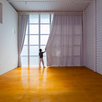 Alan Chu incorporates stage with giant doors into a home for a Brazilian actor