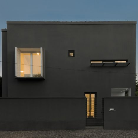 Monochrome Iranian holiday home by RooyDaad Architects is dark outside and white inside