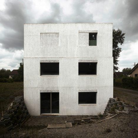 Bare concrete walls enclose HDPF's Haus Meister near Zurich