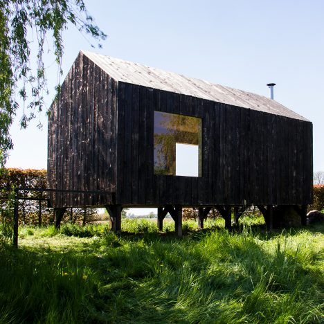 Moving walls open Stal Collectief's charred timber workshop to the elements