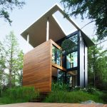 YH2 clads Quebec holiday home for a sculptor in red cedar and blackened pine