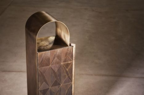 Alessandro Zambelli creates furniture inlaid with patterns of oxidised metal