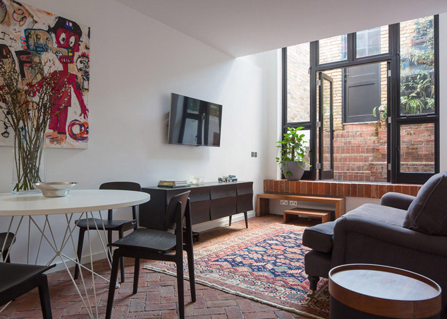 Old upholsterer's workshop in London on the top 10 brick interiors on Dezeen's Pinterest boards
