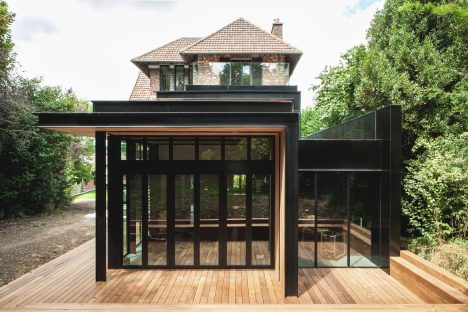 Steel and glass extension added to traditional stone house in Paris by Atelier Lame