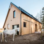 Wooden stables completed by Pook on the edge of a Finnish forest