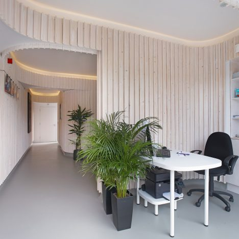 Dublin dental practice by Urban Agency features curved walls and pale wood paneling