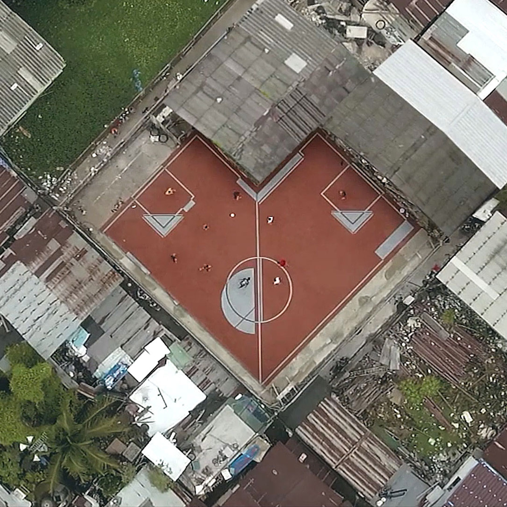 non rectangular football pitches created in bangkok slum