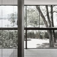 Villa Le Lac is a glass-walled house overlooking Lake Geneva