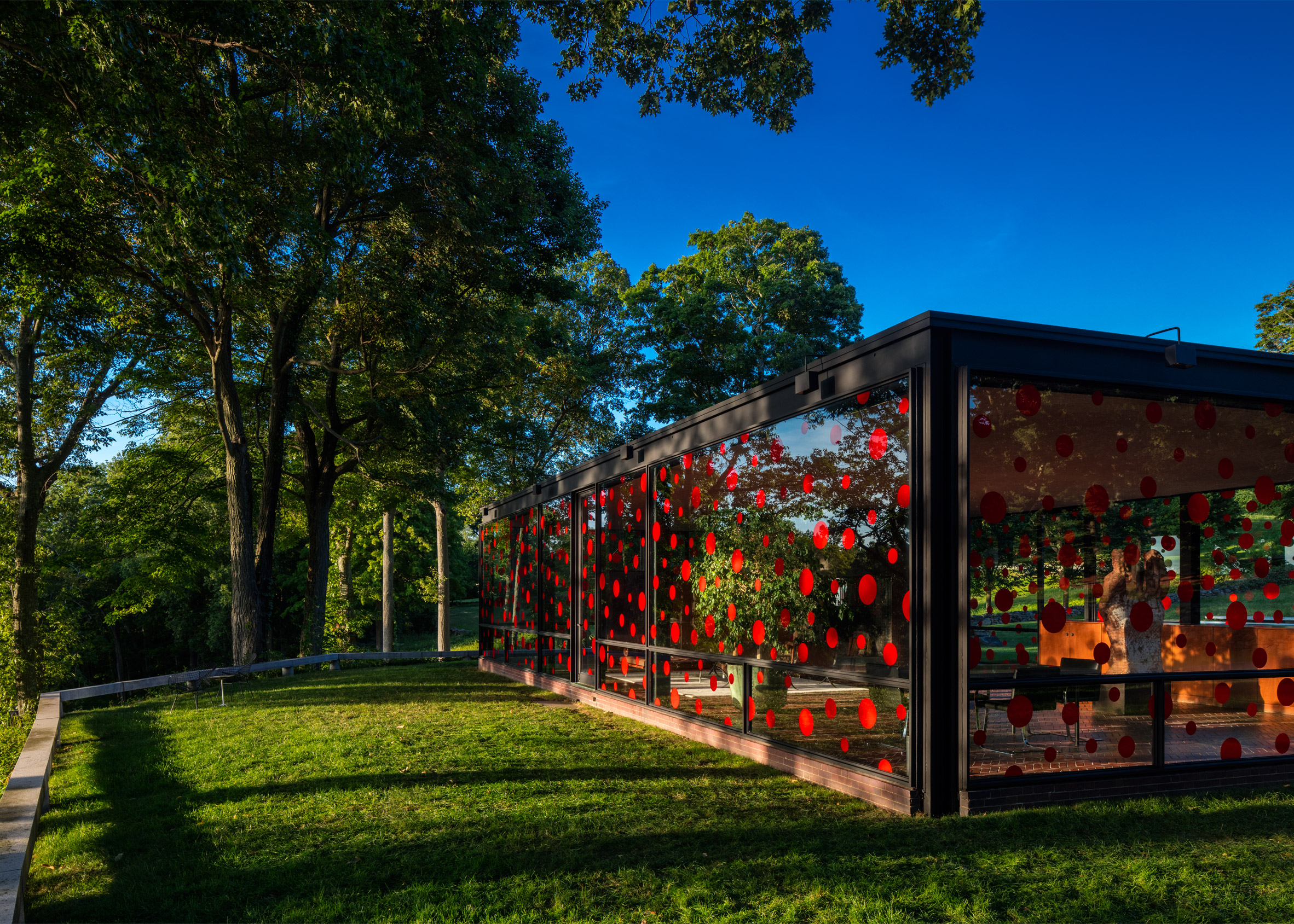 Yayoi Kusama plasters red dots across Philip Johnson's Glass House