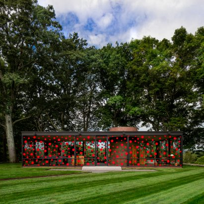 Yayoi Kusama plasters red dots across Philip Johnson's Glass House