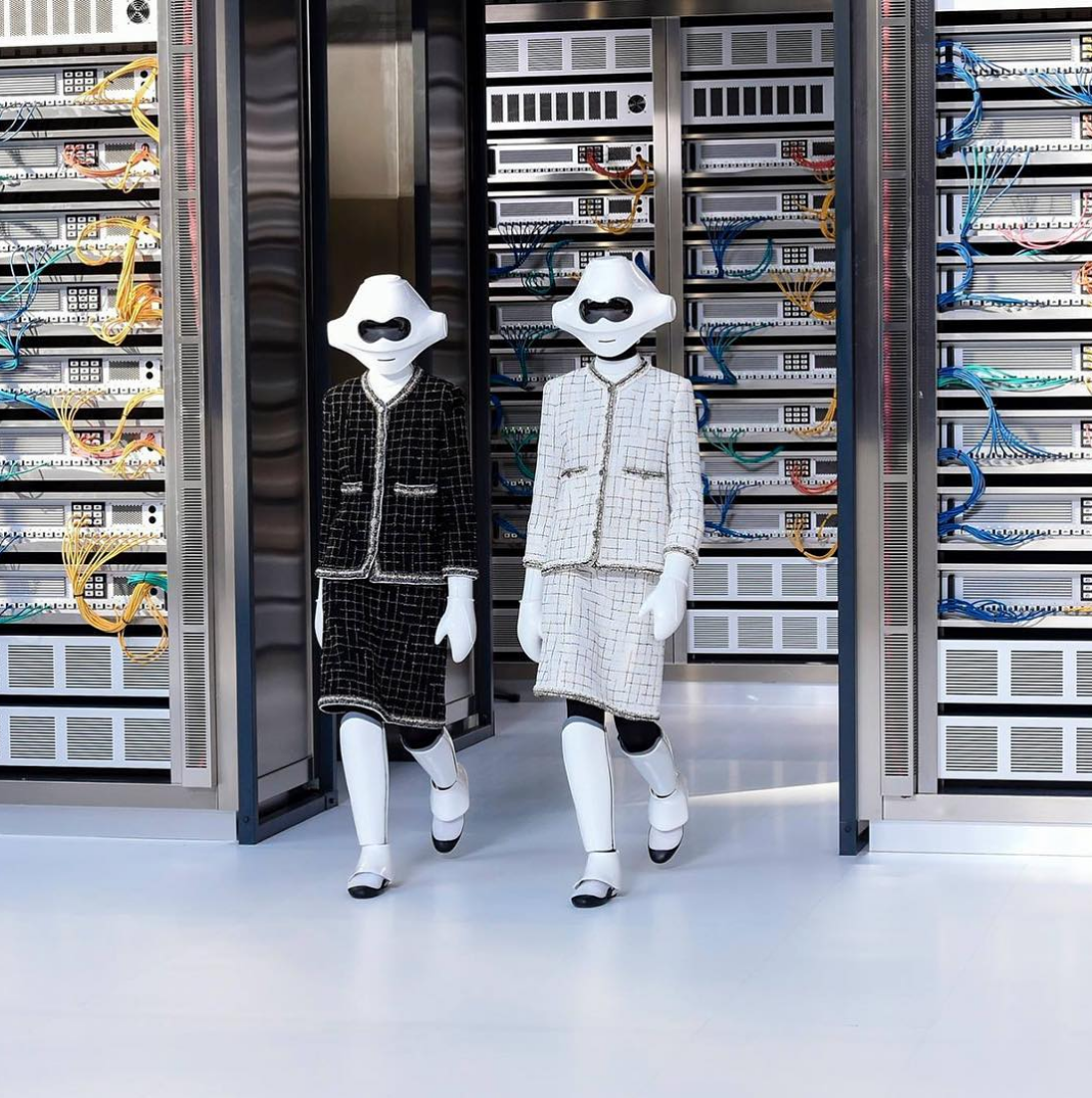 154be31f9f0 Robots walk the runway at Chanel s Spring Summer 2017 show