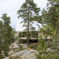 Stilted cabin is raised among the treetops on the Stockholm archipelago