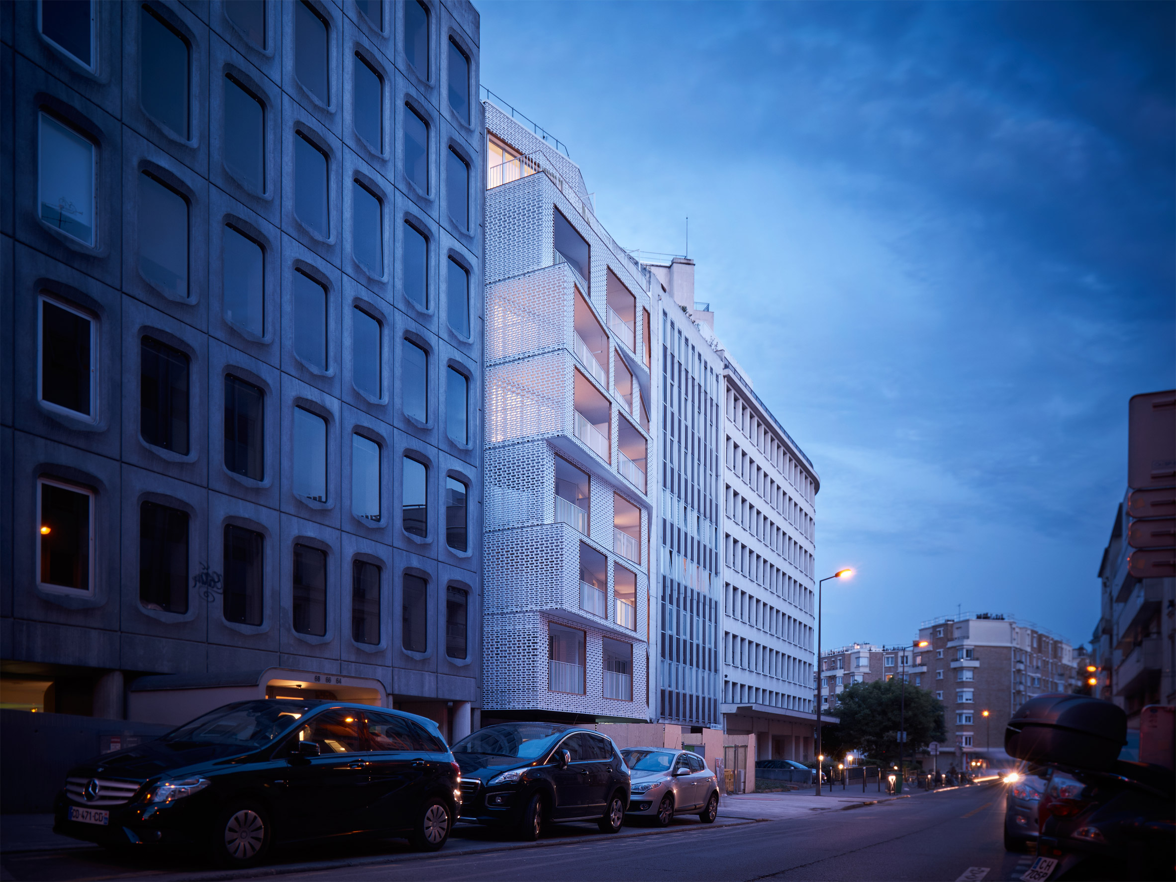 White latticework covers Parisian apartment block by Odile Guzy Architectes
