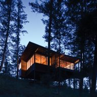 Rural Montana cabin is built on a granite cliff over Flathead Lake