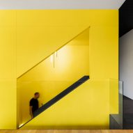 Naturehumaine adds sculptural black and yellow staircase to historic Montreal home