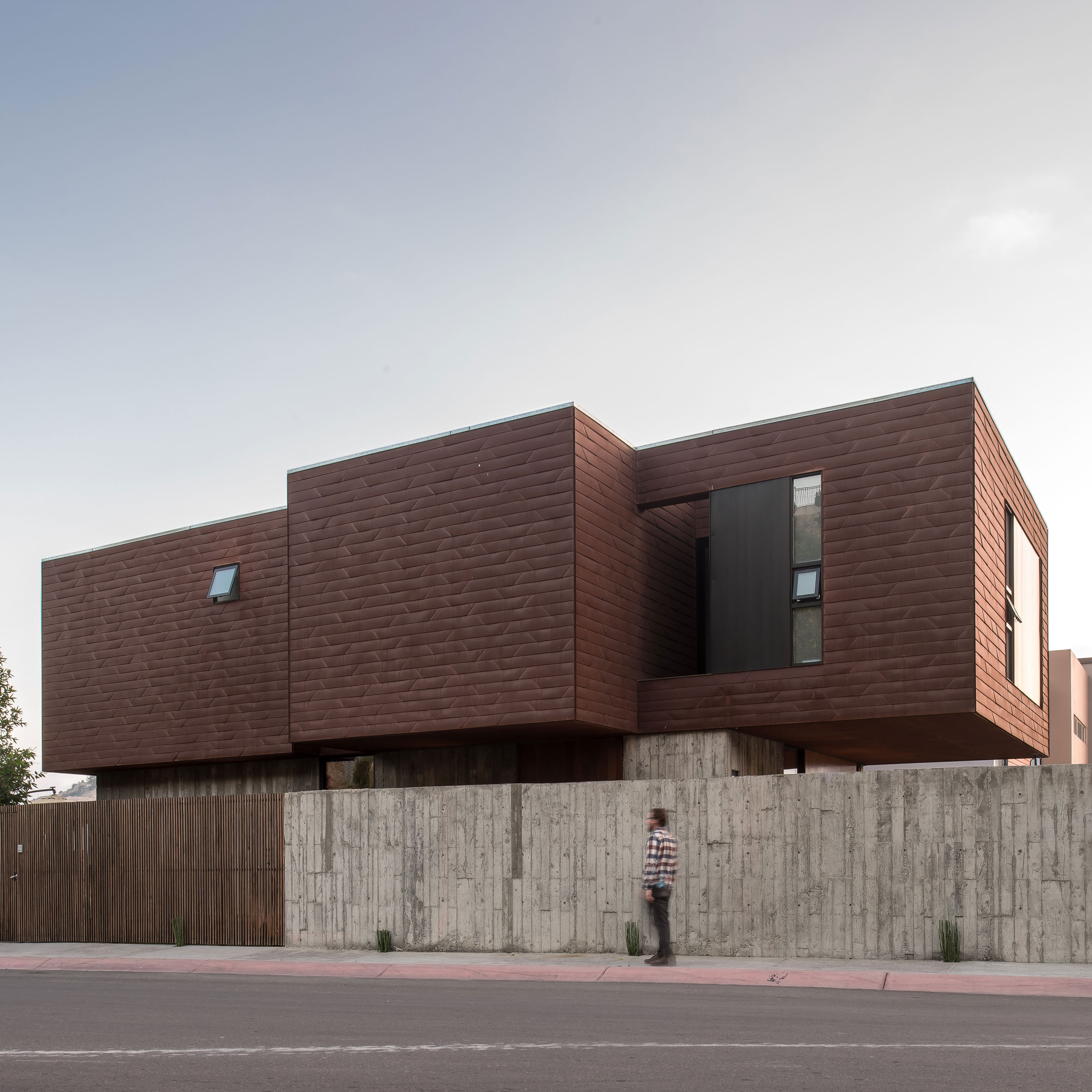 Atelier ARS screens Mexican house behind stone wall and latticework