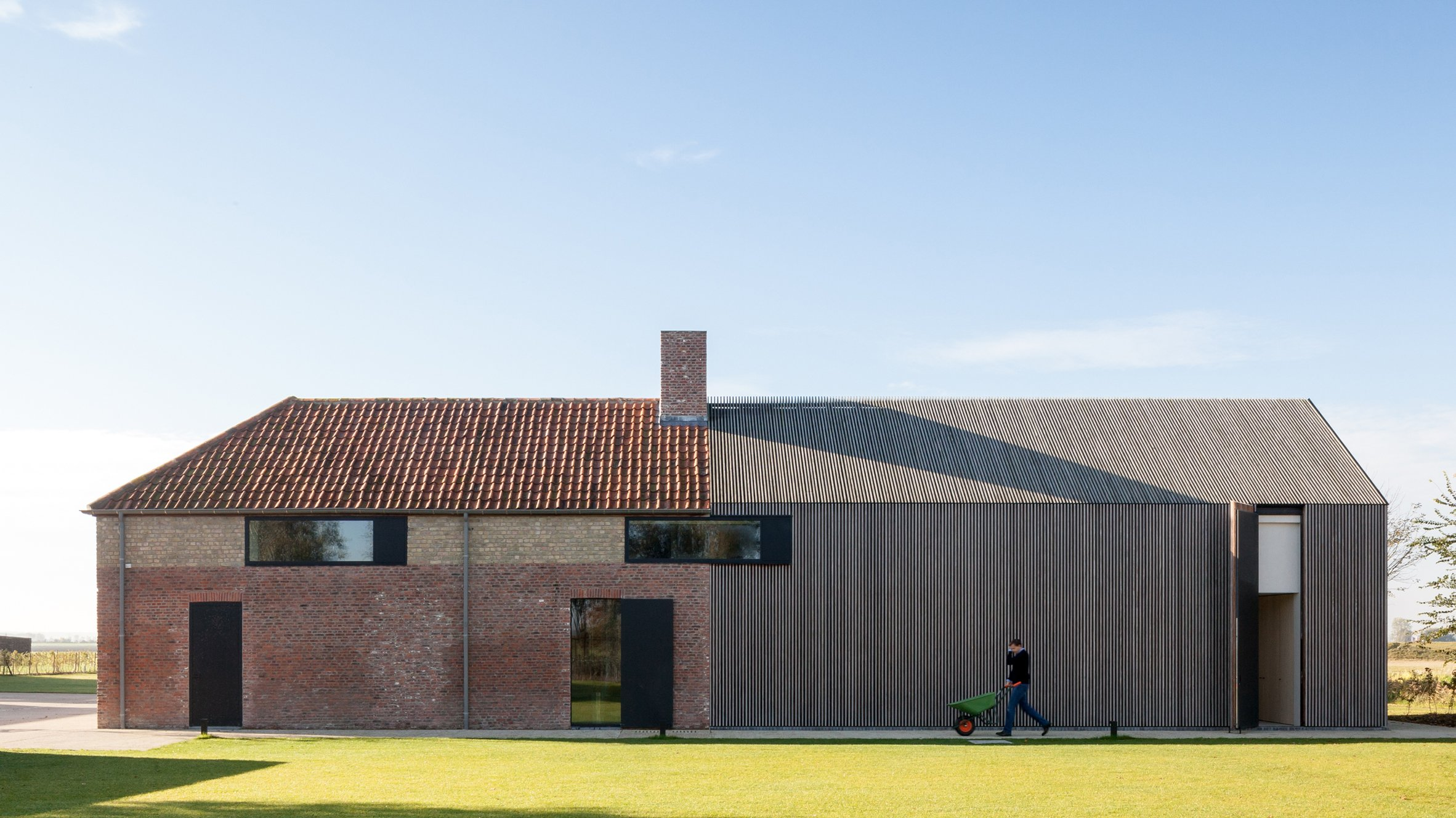 Govaert Vanhoutte Extends Farmhouse And Barn In Belgium