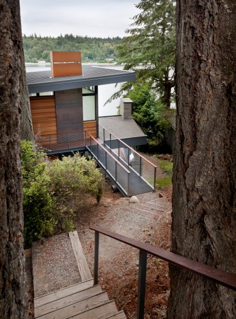 Waterfront home near Seattle is lifted on bridge-like structural supports