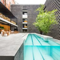 JSa lines Hotel Carlota courtyard with black concrete blocks